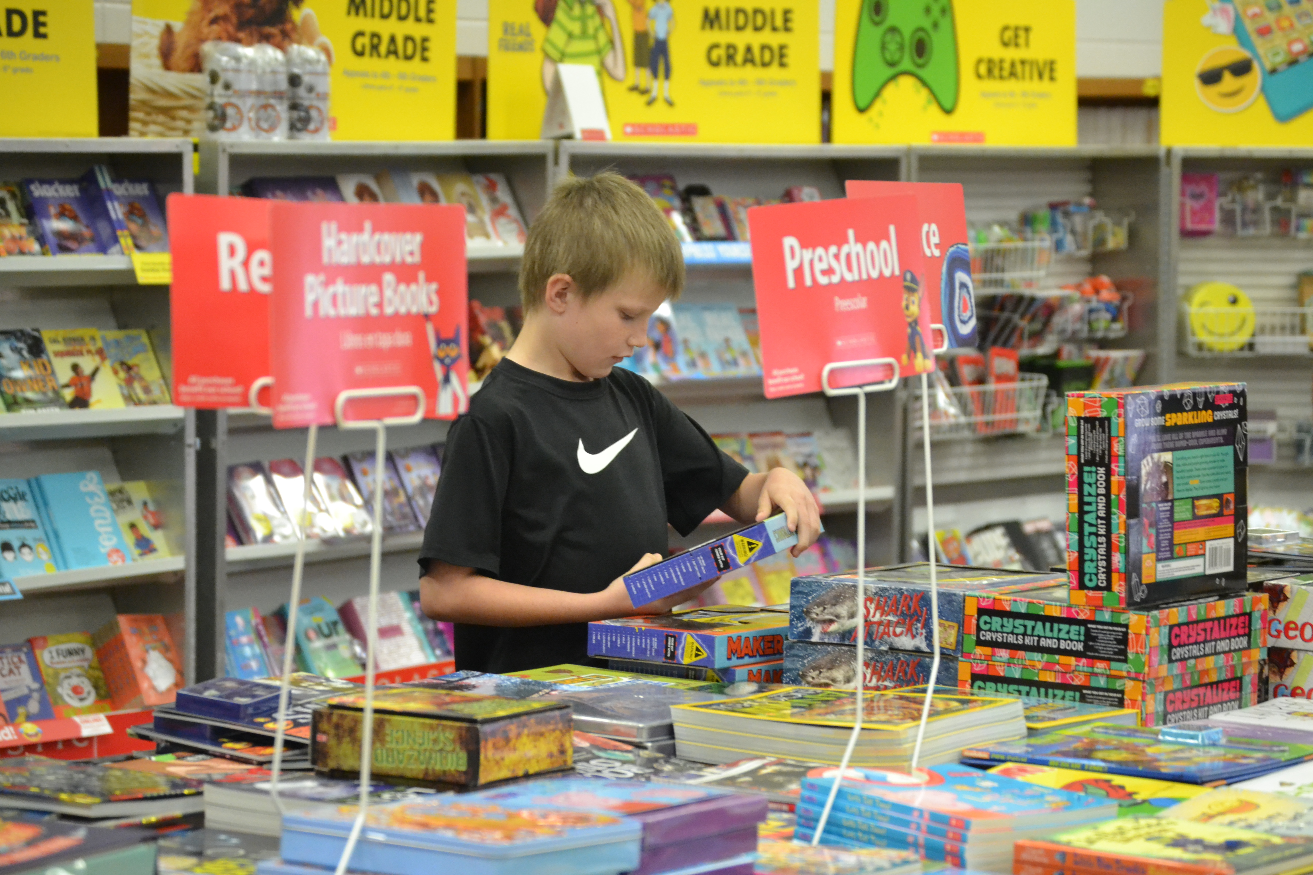 student shopping at book fair