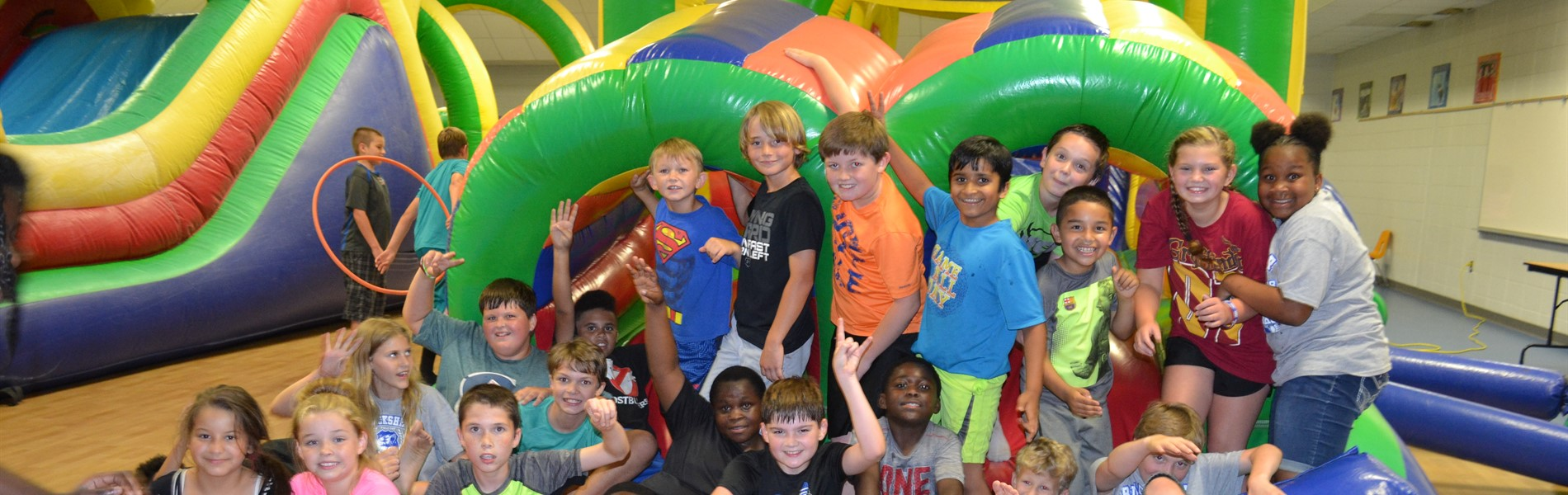 Blackshear Elementary students posing by slides