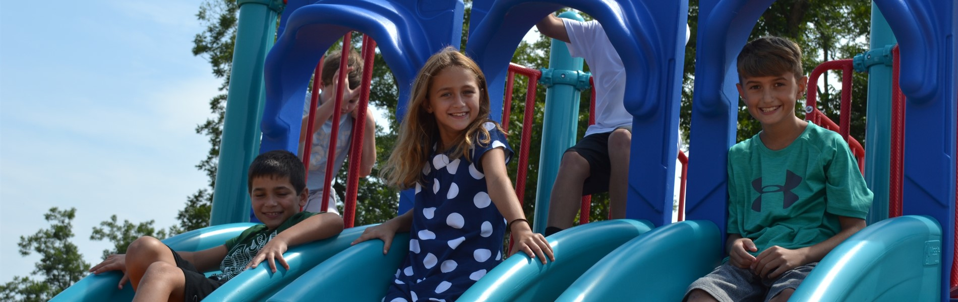 BES 4th graders on playground slides