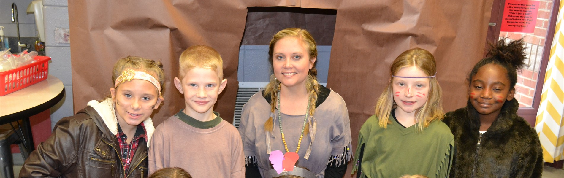 Third graders dress like Native Americans