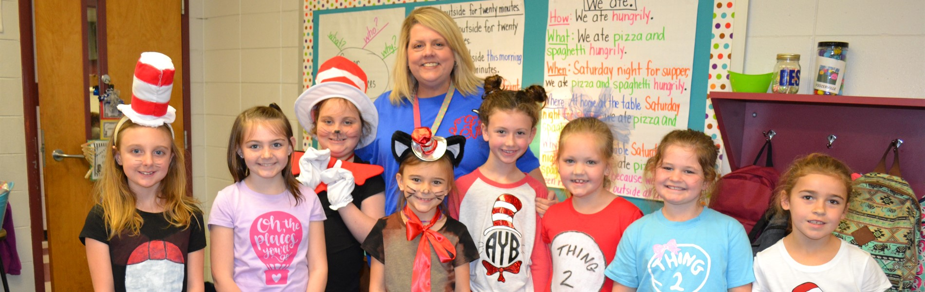 Mrs. Flynn and students dressed as Dr. Seuss characters